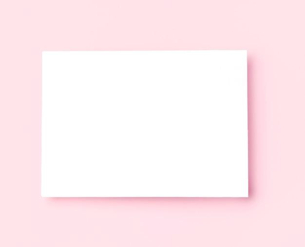 Vue de dessus cadre blanc sur fond rose