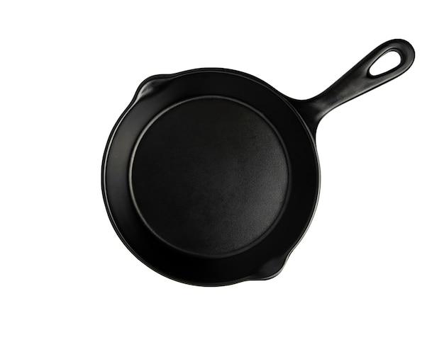 La vue de dessus de la casserole noire isolée sur blanc avec un tracé de détourage