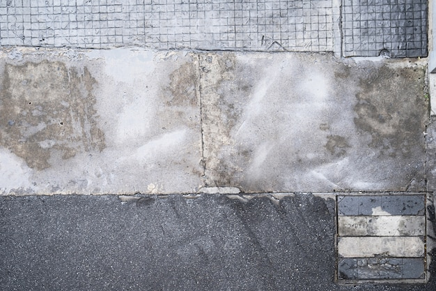Vue de dessus de la chaussée en béton, texture de la surface du sentier