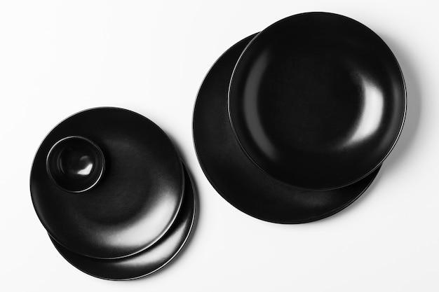 Vue de dessus composition de plaques noires sur fond blanc