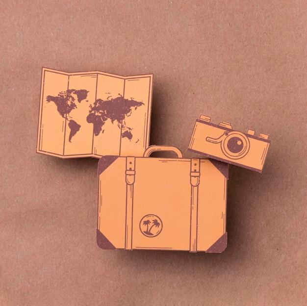 Vue de dessus concept de la journée mondiale du tourisme avec des bagages