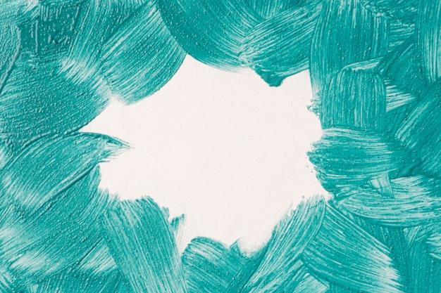 Vue de dessus des coups de pinceau de peinture bleue avec espace de copie