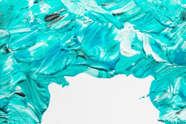 Vue de dessus des coups de pinceau de peinture créative sur la surface avec espace de copie