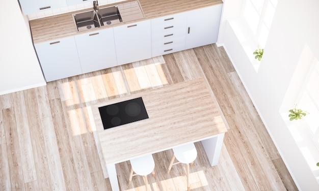 Vue de dessus d'une cuisine minimale avec îlot de cuisson