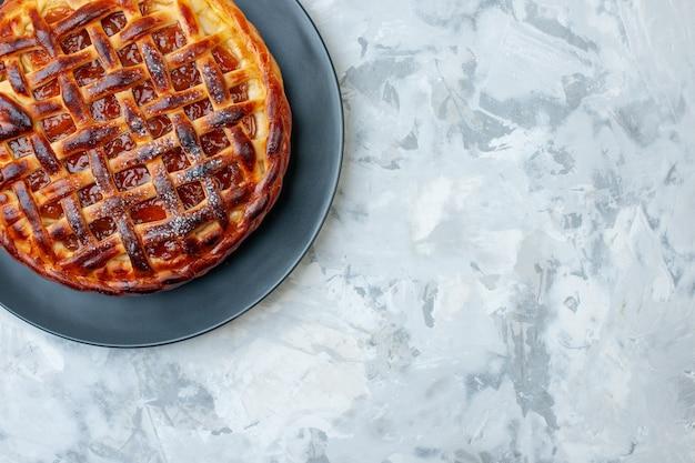 Vue de dessus délicieuse tarte aux fruits avec de la gelée sur une cuisson légère photo tarte aux biscuits dessert couleur gâteau au thé cookie