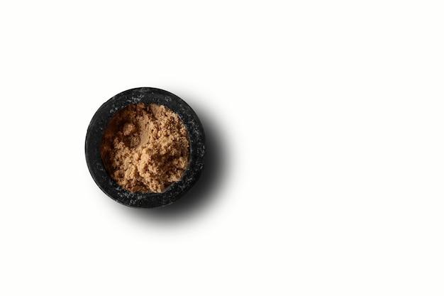 Vue de dessus du bol de roche solide noir avec des épices asiatiques. adapté à votre élément de conception.