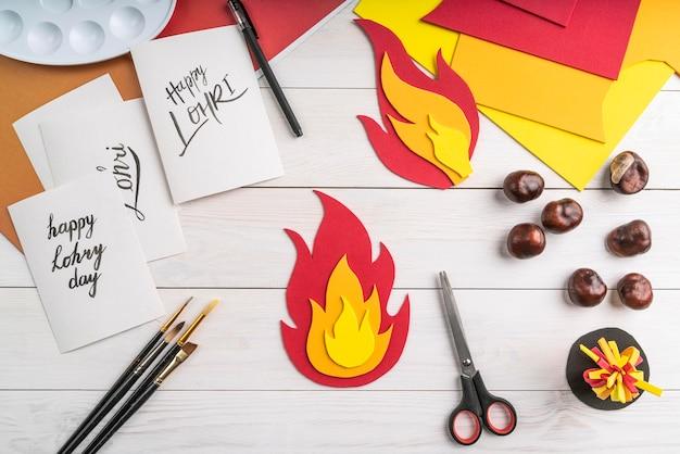 Vue de dessus du concept de jour lohri avec conception de papier feu