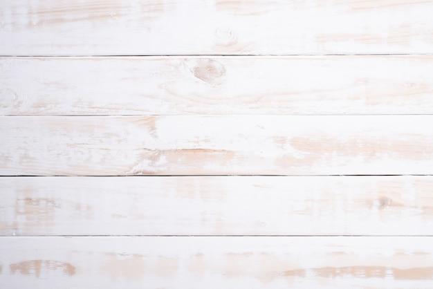 Vue de dessus du fond blanc texture bois, table en bois. lay plat.