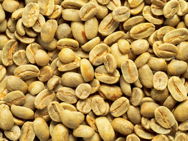 Vue de dessus du fond de grains de café vert