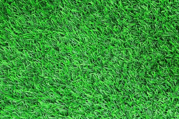 Vue de dessus du fond de texture d'herbe verte artificielle.