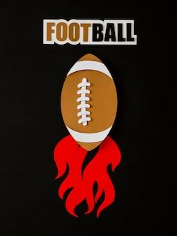 Vue de dessus du football américain avec des flammes