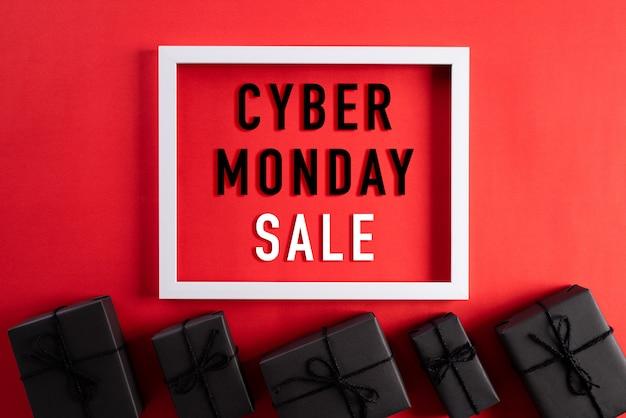 Vue de dessus du texte de vente cyber monday sur cadre photo blanc