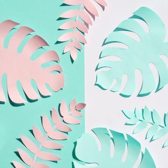 Vue de dessus de feuillage de papier rose et bleu