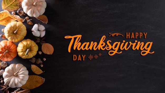 Vue de dessus des feuilles d'érable automne avec citrouille pour le concept de jour de thanksgiving.