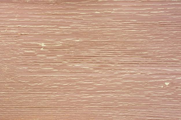 Vue de dessus d'un fond en bois rustique patiné jaune beige