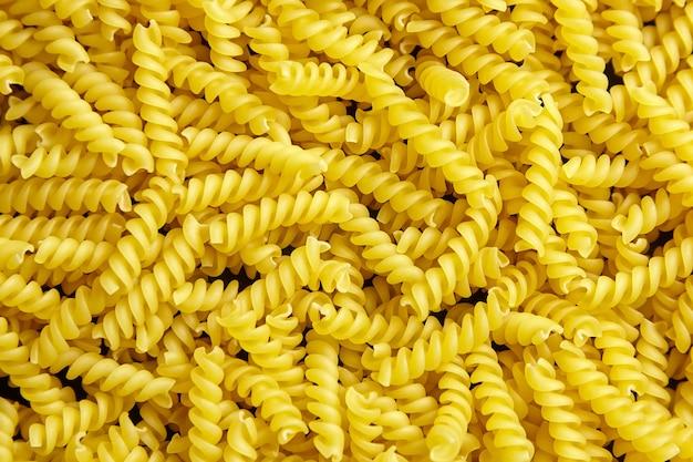 Vue de dessus de fond de nourriture de pâtes italiennes girandole
