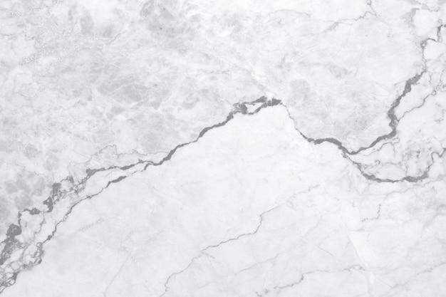Vue de dessus d'un fond de texture en marbre gris blanc, d'un sol en pierre naturelle avec un motif de paillettes sans soudure pour le design des comptoirs et l'aménagement extérieur intérieur.