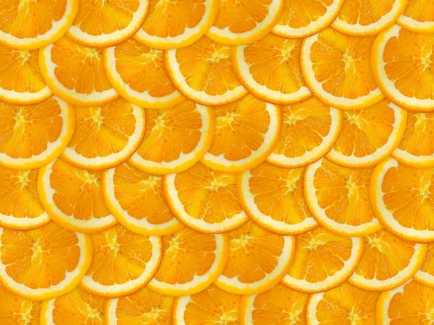 Vue de dessus de fond de tranches d'agrumes orange colorés