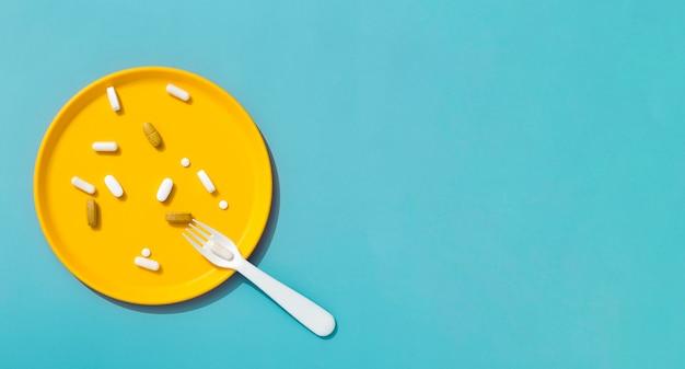 Vue de dessus de la fourchette avec plateau de pilules