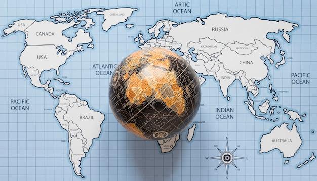 Vue de dessus globe et carte du monde