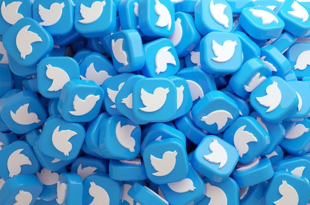 Vue de dessus d'un gros tas de boutons du logo twitter pour un arrière-plan en rendu 3d