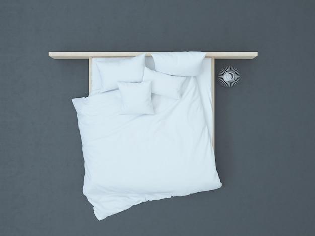 Vue de dessus sur le lit blanc