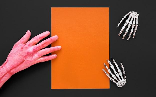 Vue de dessus des mains squelettes pour halloween