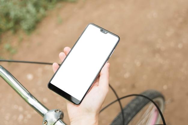 Vue de dessus maquette smartphone avec vélo défocalisé