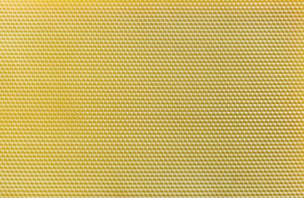 Vue de dessus de nid d'abeille jaune. texture de nid d'abeilles sans soudure.