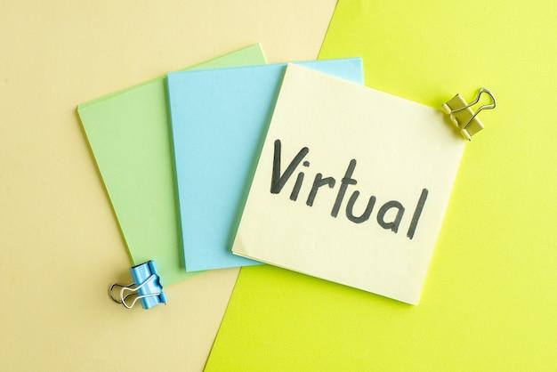 Vue de dessus note écrite virtuelle sur fond coloré copybook emploi argent bureau école entreprise salaire couleur college