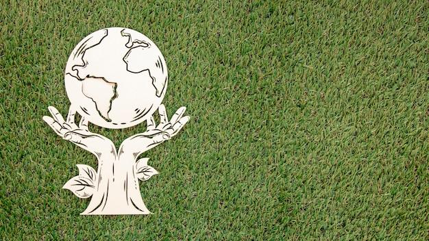 Vue de dessus objet en bois de la journée mondiale de l'environnement avec espace copie
