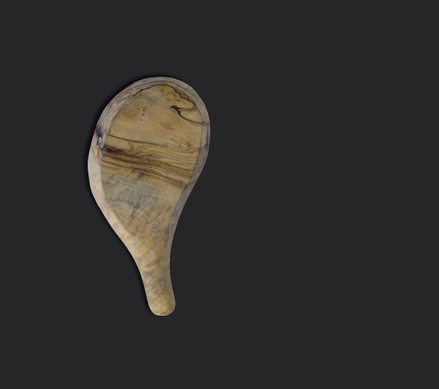 Vue de dessus une planche à découper en bois d'olivier