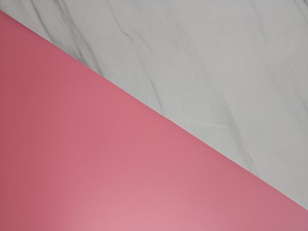 Vue de dessus plat lay de couleurs rose et gris marbre pour l'espace de texte et de fond.