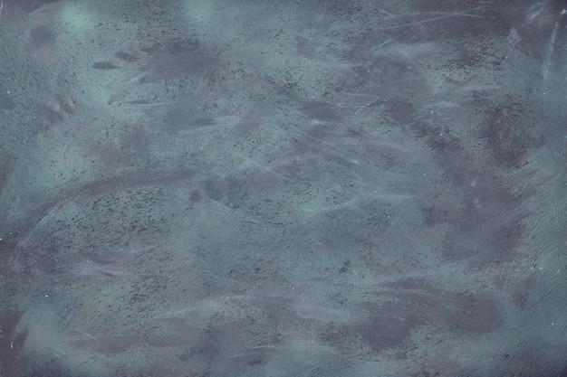 Vue de dessus, pose plate de texture texturée sombre, texture grise vierge abstraite tirée d'en haut. texture acrylique abstraite grunge avec copie-espace.