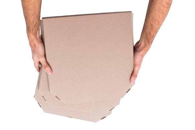 Vue de dessus des tas de boîtes avec pizza