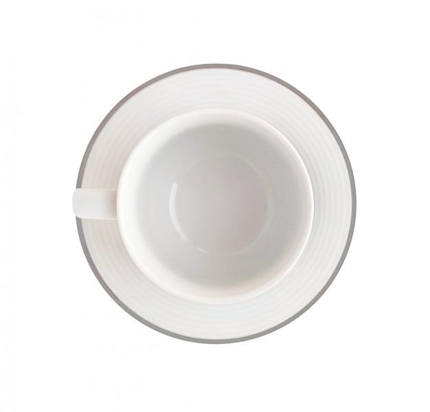 Vue de dessus de la tasse blanche vide sur soucoupe isolé sur fond blanc