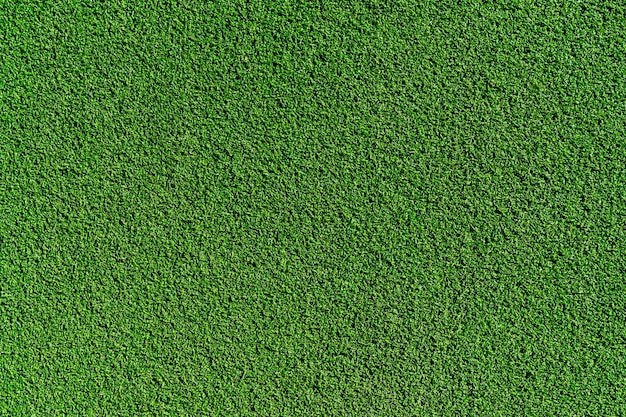 Vue de dessus de la texture d'arrière-plan du terrain de football en gazon synthétique