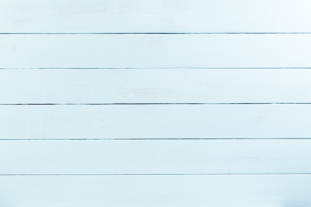 Vue de dessus de la texture du bois pastel vert, table en bois. lay plat.