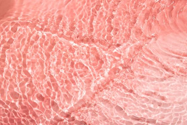 Vue de dessus de la texture de l'eau sur rose