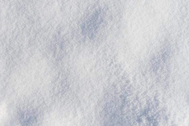 Vue de dessus de texture de neige givrée fraîche bosselée