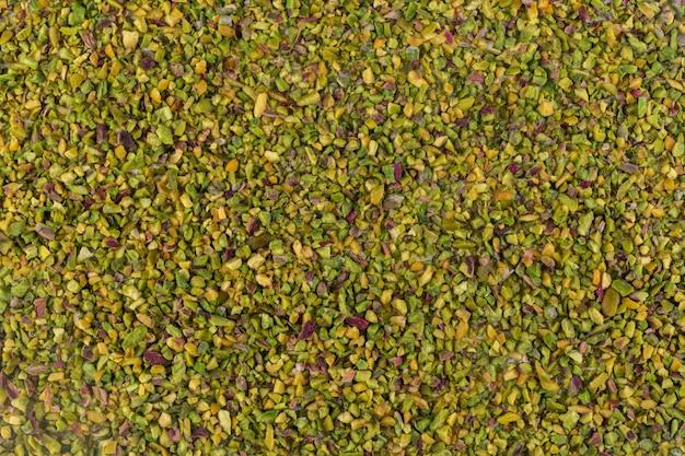Vue de dessus texture de pistaches concassées ou granulées