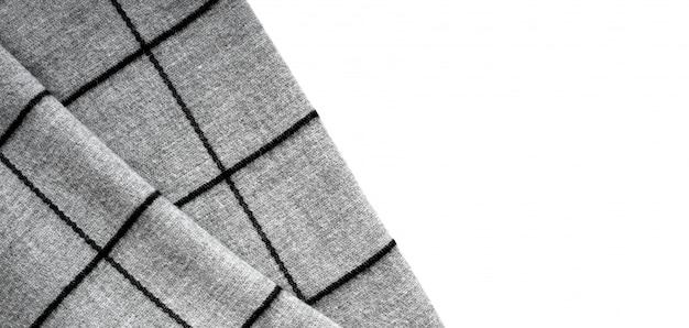 Vue de dessus de la texture d'un tissu gris dans une grande cellule sur un fond blanc avec une zone de texte