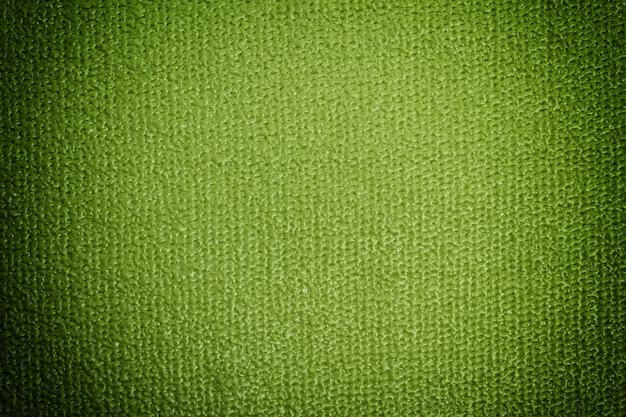 Vue détaillée du tapis de yoga. fond vert avec vignette
