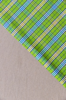 Vue en élévation du damier vert sur textile uni