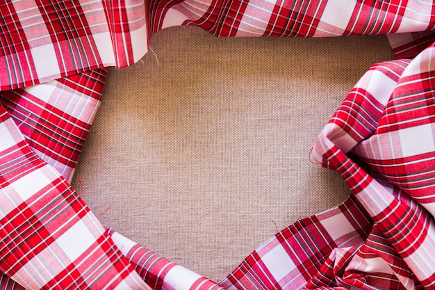 Vue élevée, de, tissu, damier rouge, former cadre