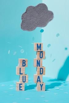 Vue de face du concept de lundi bleu avec des cubes