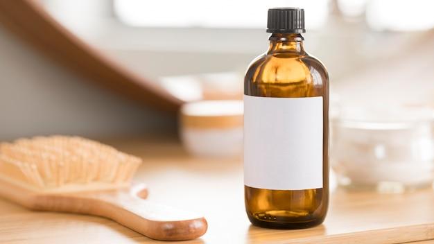 Vue de face huile et brosse saines