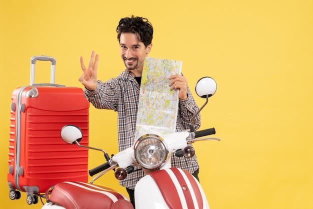 Vue de face jeune homme avec vélo et carte sur jaune