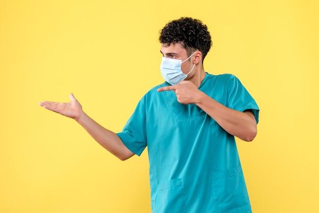 Vue de face médecin le médecin en masque pointe sa main