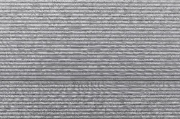 Vue de face de la surface du mur avec des lignes horizontales dessus.